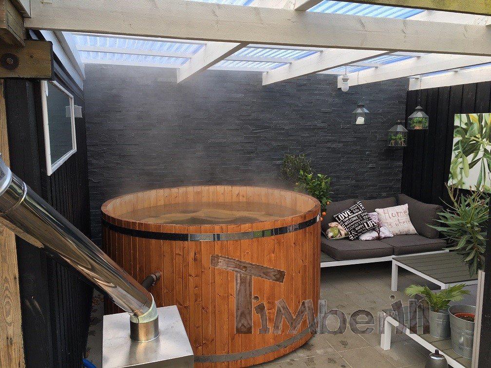 vildmarksbad i trae med ekstern ovn jacob middelfart danmark